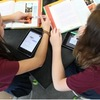 Students using personal computing devices to work in collaboration; http://www.imlc.io/
